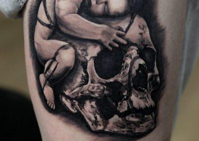 baby and skull tattoo,tatuaj craniu
