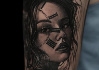 clock face woman tattoo